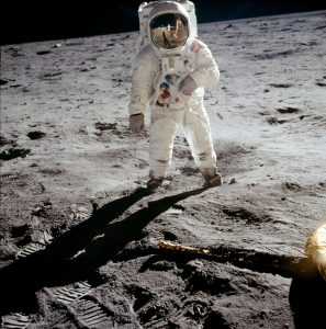 Astronaut Buzz Aldrin walks on the surface of the moon